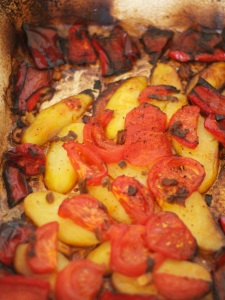 Potatoes, tomatoes and tinged peppers